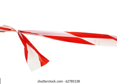 red white interdictory tape tied in a knot isolated on white
