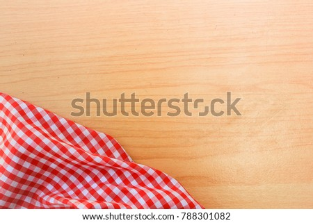 b5ed2b24c Red and white kitchen towel and green parsley leaves on rustic wooden  background. Cooking background