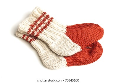 Red and white knitted socks over white background