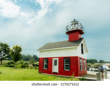 Red and white lighthouse in the harbor of Saugatuck Michigan USA on August 26th 2018