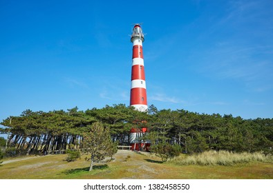 The red and white lighthouse named 'Bornrif', built in the year 1880, near the village of 'Hollum' on the Frisian island 'Ameland', North Sea, the Netherlands