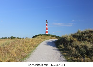 Red and white lighthouse on island Ameland, Netherland.
