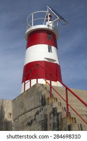 Red and white lighthouse at Sagres, Algarve, Portugal