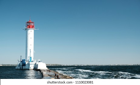 Red and white lighthouse in the sea Odessa Ukraine