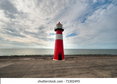 Red and white lighthouse in Zeeland the Netherlands