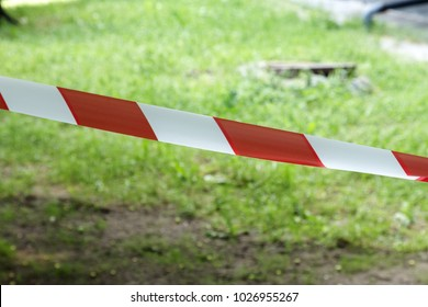Red and white lines of barrier fencing tape. Fencing red and white tape, which prohibits movement. Warning tape.