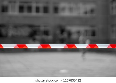 Red and white lines of barrier tape. At the metro station, the airport background. crime scene