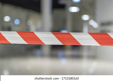 Red and white lines of the barrier tape. Red warning signal on a white background protects against penetration.
