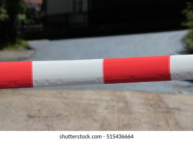Red and white lock tape on a road