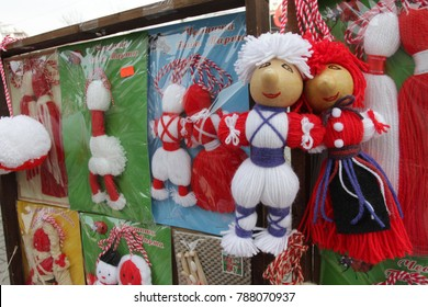 Red and white Martenitsi on outdoor market for martenici in Sofia, Bulgaria on Feb 8, 2016. Martenitsa or martenitza is given on 1st March as a symbol of health and prosperity. Red and white threads