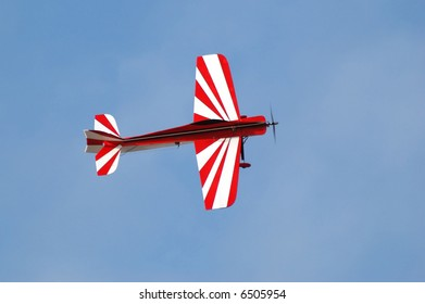 Red and white model airplane