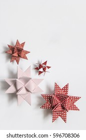 Red and white moravian stars (German christmas ornaments made from paper) on white background