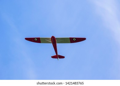 Red and white old sailplanes on the blue sky