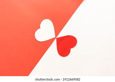 Red and white paper hearts isolated on white and red background, copy space. Heart icon vector illustration. Two different hearts are coming together. Love concept.  - Shutterstock ID 1912669582
