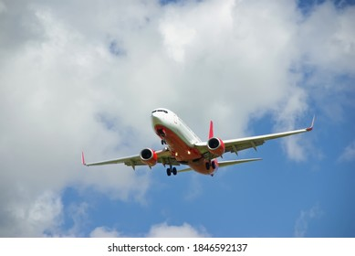 Red and White Passenger Aircraft Landing in Majorca (Spain)