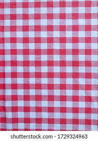 Red, white and pink checkered fabric background.