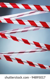 Red and white plastic barrier tape blocking the way.