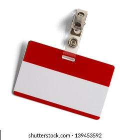 Red and White Plastic Name Badge with Metal Clip Isolated on White Background.