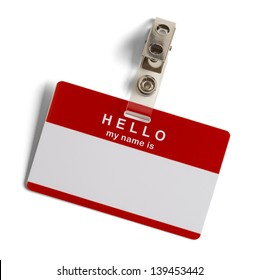 Red and White Plastic Name Tag with Hello My Name Is Isolated on White Background.
