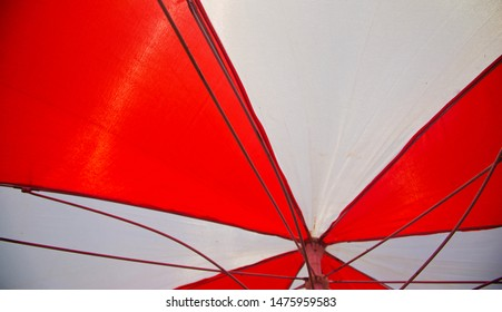 Red and white protection clothes of an umbrella
