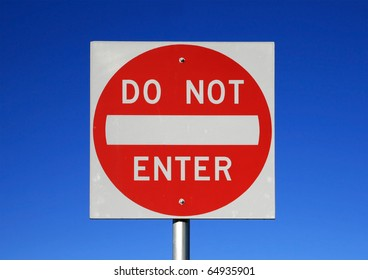 red and white reflective do not enter road sign