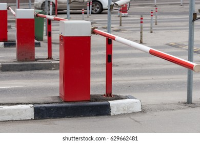Red and white Rising Arm Access Barrier at Car Parking