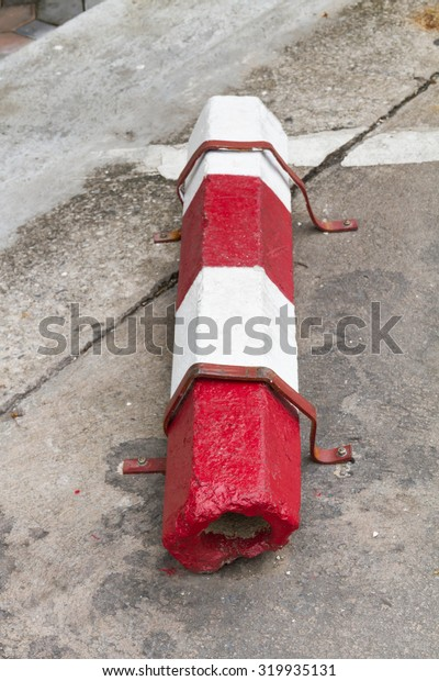 Red and white road block on the road