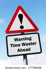 Red and white road sign depicting a warning about a time waster ahead.