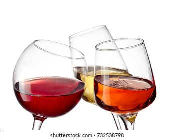 Red, white and rose wine glasses, close up