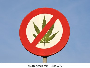 Red and white round reflective prohibition sign with Cannabis leaf