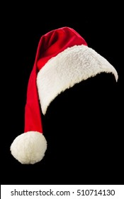 Red and white Santa Claus hat with black background