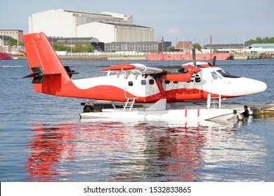 Red and white seaplane at a dock, Copenhagen, Denmark