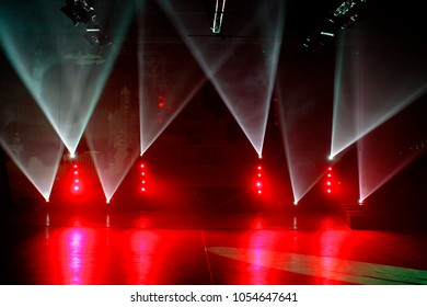 Red and white spotlights on a stage