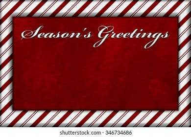 Red and White Striped Candy Cane Striped with embroidery and red plush Background with copy space for your message and text Season's Greetings
