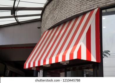 red and white striped shop awning.