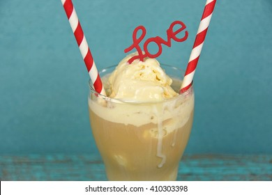red and white striped straws in root beer float with love sign