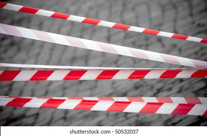 Red and white striped tapes
