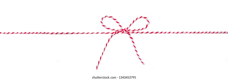 red and white striped twine with a bow