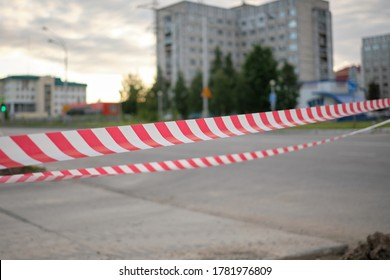 Red and white striped warning about danger and limited access tape tape. Red and white striped stretched warning barricade tape