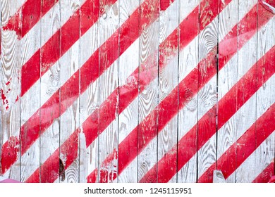 red and white stripes on wood background