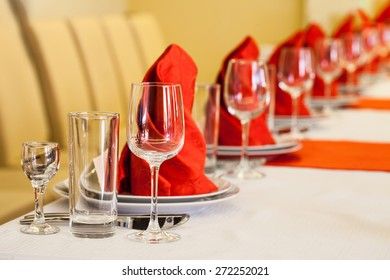 Red and white table of food and glasses