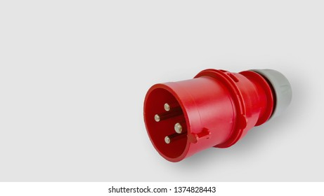 Red and white three-phase high voltage electric plug isolated on white background