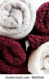 red and white towels stacked