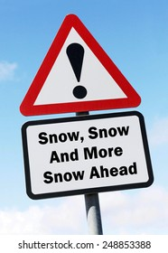 Red and white triangular  road sign with a warning of  Snow, Snow and more Snow Ahead concept against a partly cloudy sky background