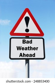 Red and white triangular  road sign with a warning of  Bad Weather Ahead concept against a partly cloudy sky background