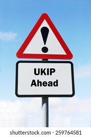 Red and white triangular road sign with a UKIP ahead concept against a partly cloudy sky background