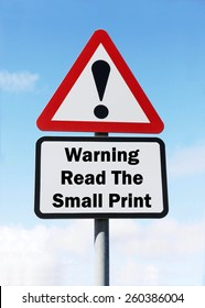 Red and white triangular road sign with warning to Read The Small Print ahead concept against a partly cloudy sky background