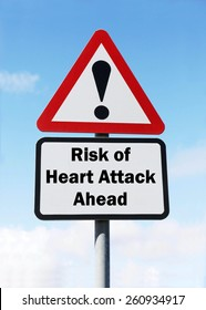 Red and white triangular road sign with warning of a Risk of a Heart Attack ahead concept against a partly cloudy sky background