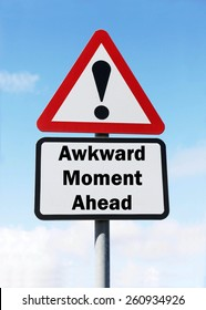 Red and white triangular road sign with warning of an Awkward Moment ahead concept against a partly cloudy sky background