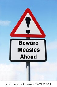 Red and white triangular road sign with warning to Beware of Measles Ahead concept against a partly cloudy sky background